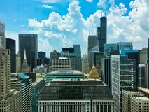 Storm clouds rolling in over Chicago`s tall buildings. Chicago, IL / USA - 7/5/18: High angle view of storm clouds rolling in over Chicago`s tallest of royalty free stock image
