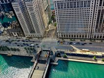 High angle view of summer in Chicago, including Chicago River, school bus, Wacker Drive, shadows cast off of buildings, etc royalty free stock photo