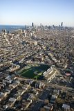 Chicago, Illinois. Aerial view of Wrigley Field with Chicago, Illinois skyline in background Royalty Free Stock Images