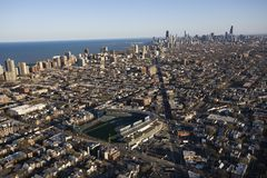 Chicago, Illinois. Aerial view of Wrigley Field with Chicago, Illinois skyline in background Royalty Free Stock Photo
