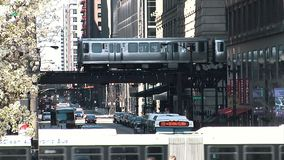 CHICAGO, ILLINOIS - April 30, 2015: Metro Train Passing And Traffic Street In Chicago Illinois Usa
