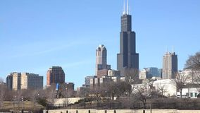 4k Chicago, Illinois skyline seen from the shores of Lake Michigan in late winter