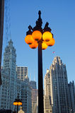 Chicago, Illinois: details of a street lamp lit and Wrigley building on September 22, 2014 Royalty Free Stock Images