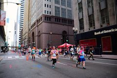 Rock and roll Chicago Half Marathon. Chicago, Illinois - July 16, 2017: Participants in the Rock and roll Chicago Half Marathon run along Loop royalty free stock images