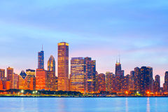 Chicago Illinois skyline at sunset. With illuminated downtown buildings Royalty Free Stock Image