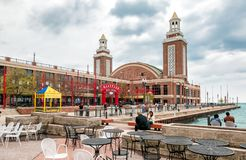 Tourists enjoy a summer day at famous Navy Pier park. Royalty Free Stock Photo