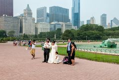 Married couple with their small children visiting Buckingham Memorial Fountain in the Chicago Grant Park. Stock Photos