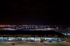 CHICAGO, ILLINOIS, UNITED STATES - MAY 11th, 2018: Outside of Chicago O`Hare International Airport at night with some royalty free stock photos