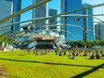 Chicago, Illinois, USA. 07 07 2018. Big group of people practice yoga in Pritzker Pavilion, park Millenium. stock photo