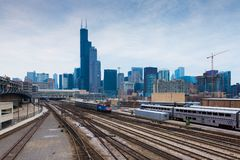 Chicago, Illinois, USA: Chicago skyline at cloudy day. Chicago - March 2017, IL, USA: Chicago skyline at cloudy day. View from Roosevelt rd. on railroad tracks Royalty Free Stock Images