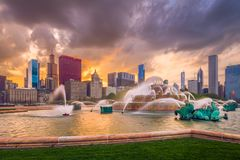 Chicago, Illinois, USA Fountain and Skyline. Chicago, Illinois, USA skyline from Buckingham Fountain at dusk royalty free stock images