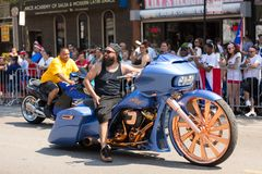 The Puerto Rican People`s Parade. Chicago, Illinois, USA - June 16, 2018: The Puerto Rican People`s Parade, Man riding a custom build motorcycle with large stock image