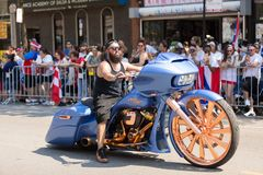 The Puerto Rican People`s Parade. Chicago, Illinois, USA - June 16, 2018: The Puerto Rican People`s Parade, Man riding a custom build motorcycle with large royalty free stock photos