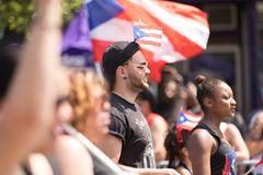 The Puerto Rican People`s Parade. Chicago, Illinois, USA - June 16, 2018: The Puerto Rican People`s Parade, puerto rican man with the puerto rican flag during stock photography