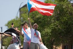 The Puerto Rican People`s Parade. Chicago, Illinois, USA - June 16, 2018: The Puerto Rican People`s Parade, Puerto Rican people on top of a float celebrating stock photos