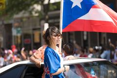 The Puerto Rican People`s Parade. Chicago, Illinois, USA - June 16, 2018: The Puerto Rican People`s Parade, Puerto rican woman waving the puerto rican flag going stock photos