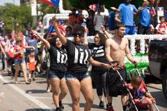 The Puerto Rican People`s Parade. Chicago, Illinois, USA - June 16, 2018: The Puerto Rican People`s Parade, puerto rican woman waving the puerto rican flag royalty free stock photo