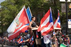The Puerto Rican People`s Parade. Chicago, Illinois, USA - June 16, 2018: The Puerto Rican People`s Parade, Puerton rican people riding on cars celebrating with stock image