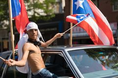 The Puerto Rican People`s Parade. Chicago, Illinois, USA - June 16, 2018: The Puerto Rican People`s Parade, Puerton rican people riding on cars celebrating with stock photo