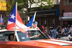 The Puerto Rican People`s Parade. Chicago, Illinois, USA - June 16, 2018: The Puerto Rican People`s Parade, Puerton rican people riding on cars celebrating with royalty free stock photos