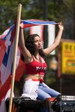 The Puerto Rican People`s Parade. Chicago, Illinois, USA - June 16, 2018: The Puerto Rican People`s Parade, Puerto rican woman waving the puerto rican flag going royalty free stock images