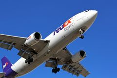FedEx cargo plane on final approach stock images