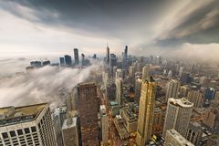 Chicago, Illinois, USA Skyline. From above with storm clouds and fog rolling in royalty free stock photography