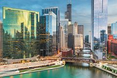 Chicago, Illinois USA skyline over the river. At twilight royalty free stock photo