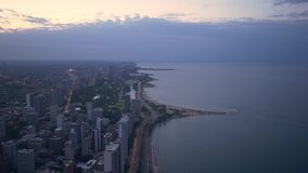 Chicago and Lake Michigan from above - amazing aerial view in the evening - CHICAGO. UNITED STATES - JUNE 11, 2019 stock video footage