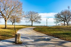 Chicago Lakefront Trail with a Drinking Fountain during Autumn with Bare Trees royalty free stock image