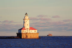 Chicago Light House. With boat in Lake Michigan with cloud and blue sky at sunset Royalty Free Stock Photography