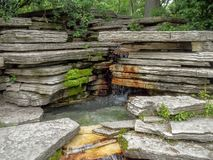 Chicago lily pond limestone waterfall royalty free stock photography