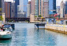 Chicago lock with boats. Chicago, USA - May 24, 2014: Chicago lock gates are joining before locking operation starts, looking towards downtown Chicago Stock Photo