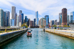 Chicago lock with skyline. Chicago, USA - May 24, 2014: Several small boats waiting in Chicago lock Royalty Free Stock Photos