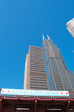 Chicago: looking up at skyline and Willis Tower from a canal cruise on Chicago River on September 22, 2014 Stock Photos