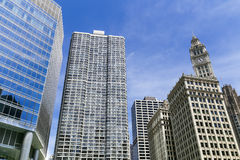 Chicago Loop with blue sky. Chicago, USA - May 24, 2014: Facades of several skyscrapers in the Chicago Loop Area with different architectural styles Royalty Free Stock Photo