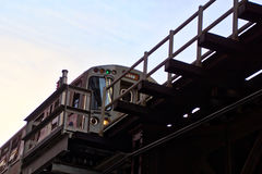 Chicago Loop train during rush hour commute. Chicago Loop elevated el train during evening commute. Elevated train picture taken from below looking up Royalty Free Stock Images