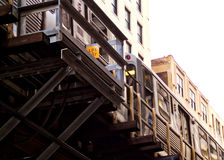 Chicago Loop el train passing overhead during rush hour commute. Chicago Loop elevated el train during evening commute. Elevated train picture taken from below Royalty Free Stock Photo