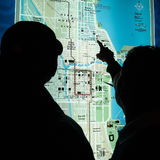 Chicago map. Man pointing destination on blue lightbox Chicago citymap Royalty Free Stock Images