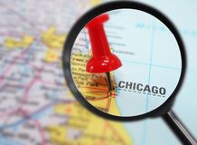 Chicago map closeup. Closeup of Chicago map with red tack and magnifying glass Royalty Free Stock Photography