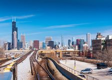 Chicago, USA: Metro tracks and Chicago skyline on the background. Chicago - March 2017, Illinois, USA: Metro tracks and Chicago skyline on the background Stock Image