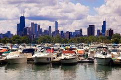 Chicago marina. Boats moored on Lake Michigan marina with Chicago skyline in background under cloudscape, Illinois, U.S.A Royalty Free Stock Images