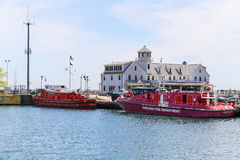 Chicago Marine Safety Station. Chicago, USA - May 24, 2014: Chicago Marine Safety Station and two fireboats of Chicago fire department at Lake Michigan Royalty Free Stock Photography