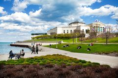 CHICAGO - May 4, 2014: People sit on the lawn of the Field Museu Royalty Free Stock Photo