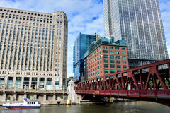 Chicago Merchandise Mart and city buildings beside Chicago river Royalty Free Stock Image