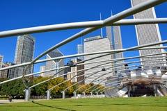 Chicago Millennium Park Pritzker Pavilion featured steel frame. City buildings and Pritzker Pavilion with featured steel frame at Millennium Park in Chicago Stock Photos
