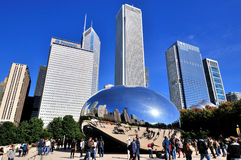 Chicago Millennium Park, Slivery Bean and city buildings. Famous Chicago Millennium Park and Slivery Bean sculpture, Photo taken in October 6th, 2014 Stock Photos
