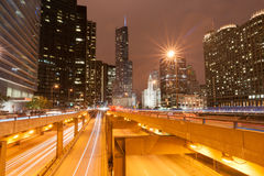 Chicago multi-level road system leads into city at night Stock Photo