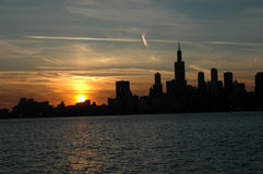 Chicago at night. Sunset falls over the Chicago skyline at dusk; silhouette Stock Images