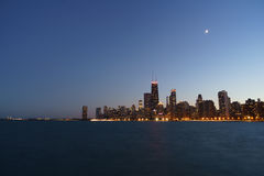 Chicago Night. Chicago cityscape with water in the foreground at night. Clear, open sky. No clouds. Distant moonlight Royalty Free Stock Image